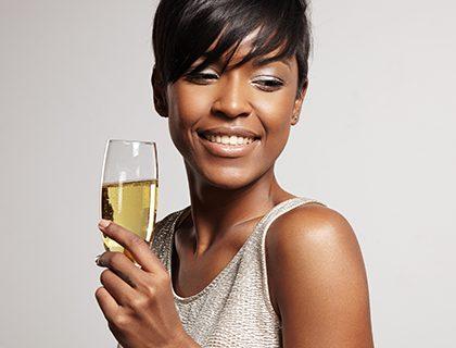 Black girl drinking champagne