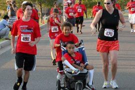Boy pushing wheelchair